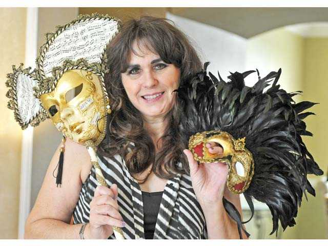 Leslie Berra holds two of her favorite masks.