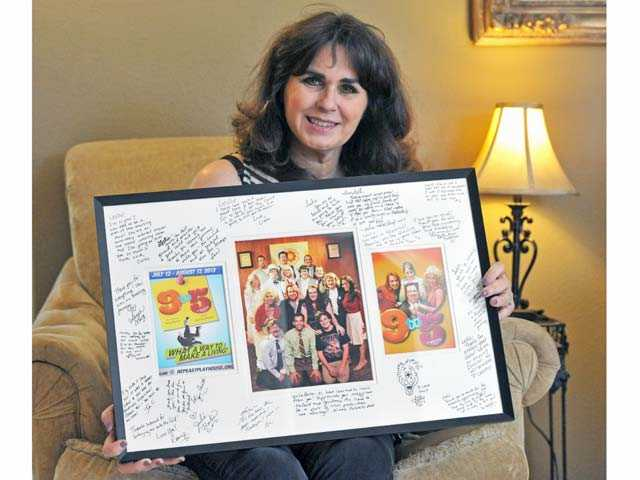 "Berra with memorabilia from the musical ""9 to 5"" which she directed at the Repertory East Playhouse in Newhall."