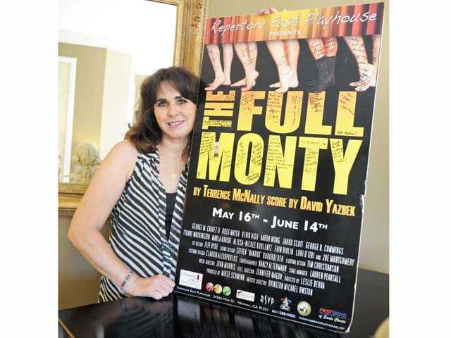 "Leslie Berra with a poster from ""The Full Monty"" which she directed at The REP."
