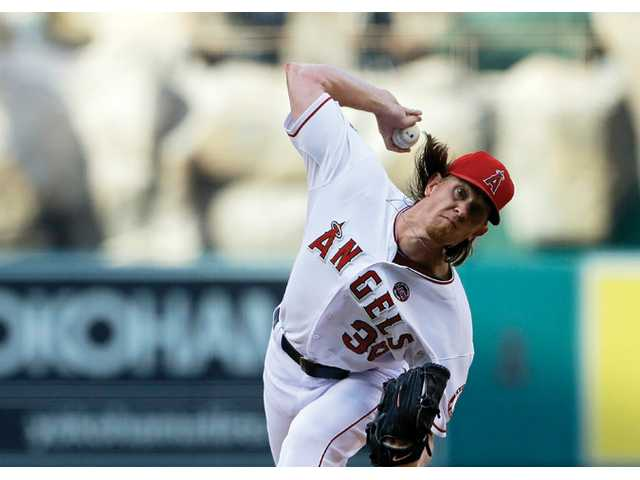 Los Angeles Angels starter Jered Weaver pitches to the Toronto Blue Jays in the first inning in Anaheim on Saturday.