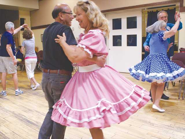 Roberta Searcy dances with her partner during the square dance event on Sunday at the Santa Clarita Valley Senior Center in Newhall. Photo by Jim Holt.