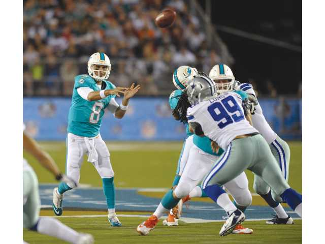 Miami Dolphins quarterback and Hart alumnus Matt Moore (8) throws against the Dallas Cowboys at the Pro Football Hall of Fame exhibition game on Sunday in Canton, Ohio.