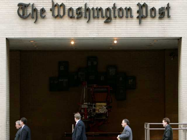 Pedestrians walking past the main entrance to the Washington Post in Washington. Amazon founder Jeff Bezos to buy The Washington Post for $250 million.