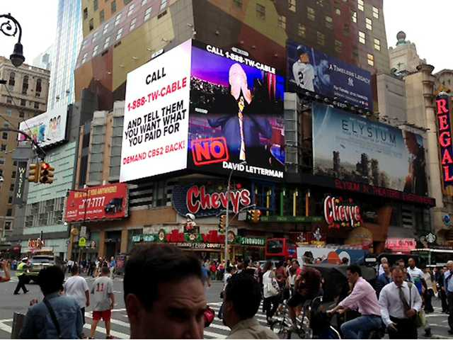 A CBS ad is shown in Times Square in New York on Friday. Three million Time Warner Cable customers in New York, L.A. and Dallas lost access to CBS programming.