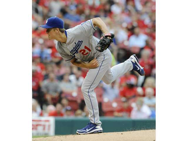 Los Angeles Dodgers starting pitcher Zack Greinke throws against the St. Louis Cardinals on Monday in St. Louis.