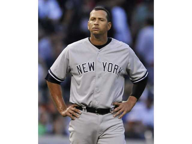 New York Yankees third baseman Alex Rodriguez looks on during a game against the Chicago White Sox in Chicago on Monday.
