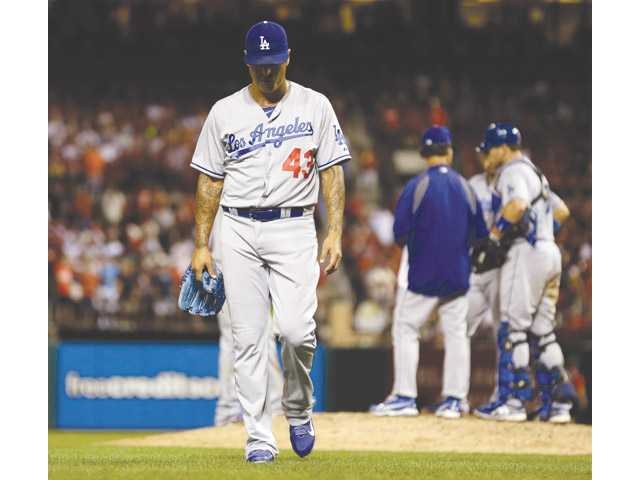 Los Angeles Dodgers relief pitcher Brandon League walks off the field against the St. Louis Cardinals on Tuesday in St. Louis.