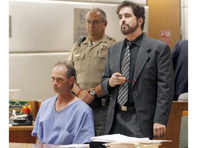 Nathan Louis Campbell, 38, a transient from Colorado, seated left, appears with attorney Phillip Dubee in Los Angeles Superior Court on Tuesday.