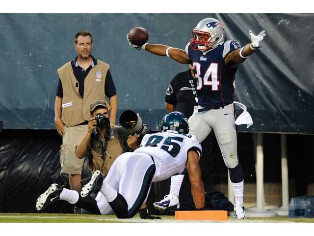 New England Patriots running back Shane Vereen, right, celebrates after scoring a touchdown against Philadelphia Eagles linebacker Mychal Kendricks during the first half of a preseason game on Friday in Philadelphia.