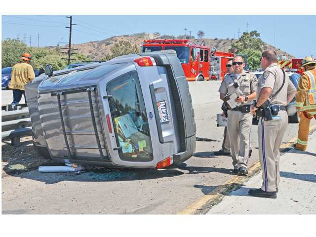 One person was injured and transported to the hospital after a rollover crash on Interstate 5 near Rye Canyon Road Saturday afternoon. Phot by Rick McClure/For The Signal.
