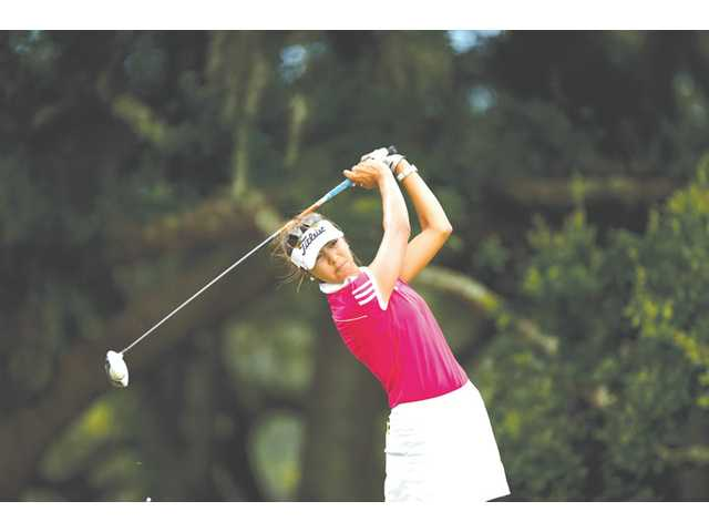 Valencia graduate Alison Lee plays her tee shot at the 10th hole during the semifinal round of match play at the 2013 U.S. Women's Amateur at Country Club of Charleston in Charleston, S.C. on Saturday.