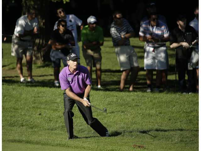 Jim Furyk watches his shot out of the rough on the 16th hole during the third round of the PGA Championship at Oak Hill Country Club on Saturday in Pittsford, N.Y.
