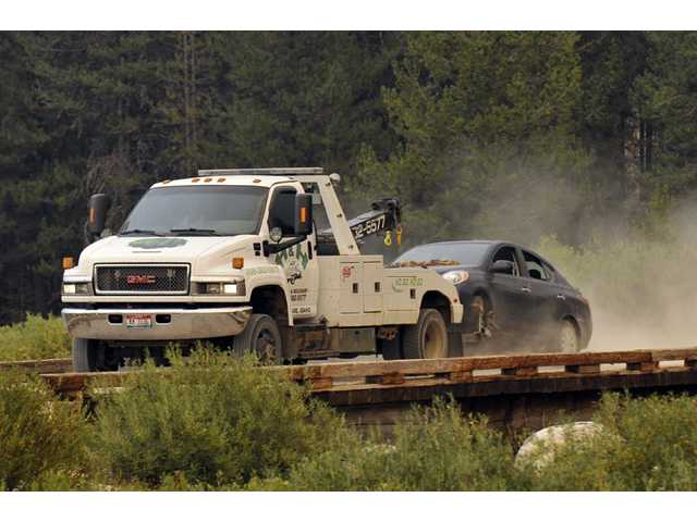 James Dimaggio's car is towed to the town of Cascade after dectives finished searching it on a trail head bordering the Frank Church River of No Return Wilderness on Saturday.