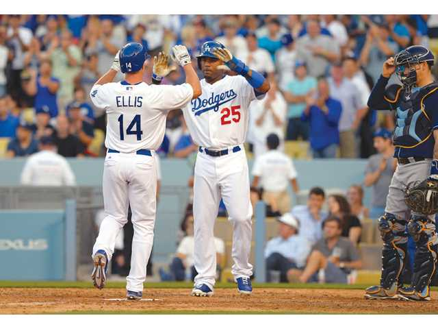 Los Angeles Dodgers Mark Ellis, left, and Carl Crawford celebrate after Ellis hit a home run on Sunday in Los Angeles.