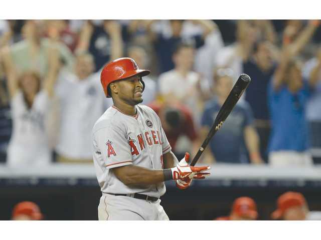 Los Angeles Angels third baseman Chris Nelson reacts after striking out against the New York Yankees on Monday in New York.