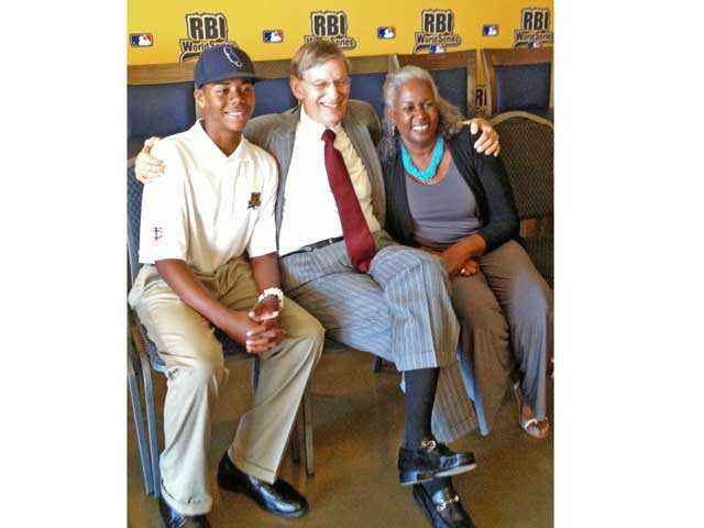 Hunter Greene, left, of Stevenson Ranch, sits with MLB Commissioner Bud Selig, center, and Sharon Robinson, daughter of Jackie Robinson.