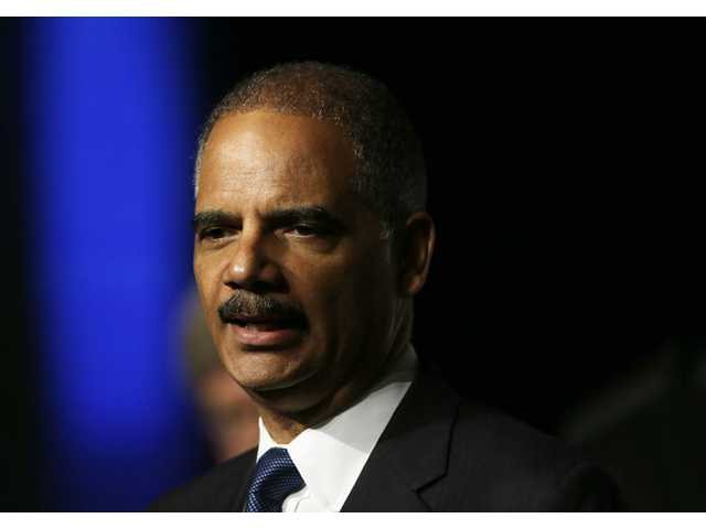 United States Attorney Gen. Eric Holder speaks to the American Bar Association Annual meeting on Monday in San Francisco.