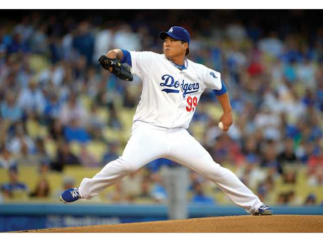 Los Angeles Dodgers starting pitcher Hyun-Jin Ryu throws to the plate against the New York Mets on Tuesday in Los Angeles.