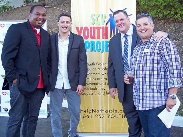 Left to right, comedians Roy Wood, Jr., Jeff Sutphen, Billy Gardell and SCV Youth Project board vice president Martin Rodriguez at Comics for a Cause to benefit the SCV Youth Project.