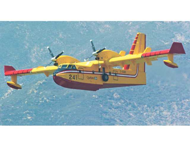 "One of two ""Super Scoopers"" practices drops at Castaic Lake in 2010. Two of the firefighting aircraft are leased each year by Los Angeles County. Signal file photo"