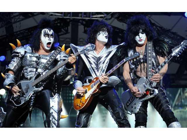 Kiss bassist Gene Simmins , guitarist Tommy Thayer and singer Paul Stanley of the US band Kiss perform on stage in Berlin, Germany on June 12.