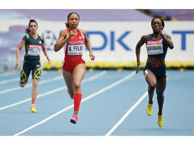 Santa Clarita Valley resident Allyson Felix, center, and France's Myriam Soumare, right, compete in a women's 200-meter heat at the World Athletics Championships in Moscow, Russia on Thursday.