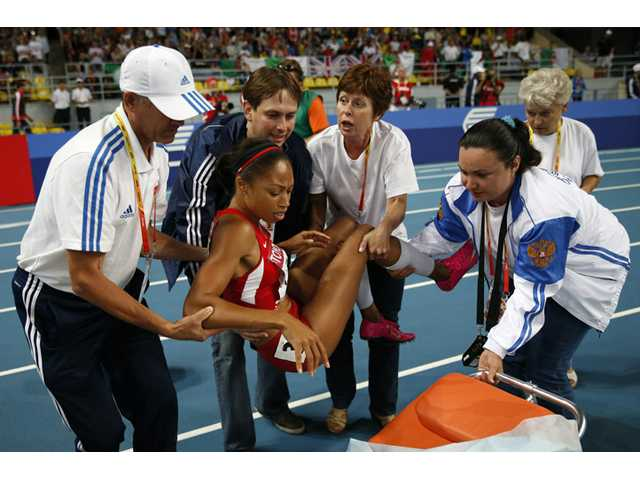 United States' Allyson Felix is carried to a stretcher after being injured in the women's 200-meter final at the World Athletics Championships in the Luzhniki stadium in Moscow, Russia on Friday.