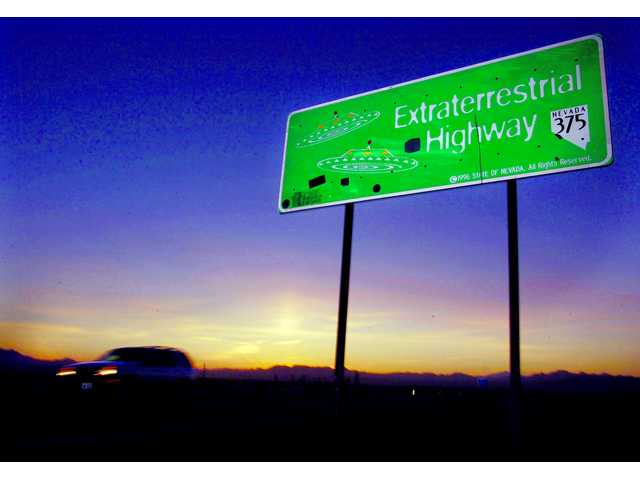 In this file photo a car moves along the Extraterrestrial Highway near Rachel, Nevada. The CIA is acknowledging the existence of Area 51 in newly declassified documents.