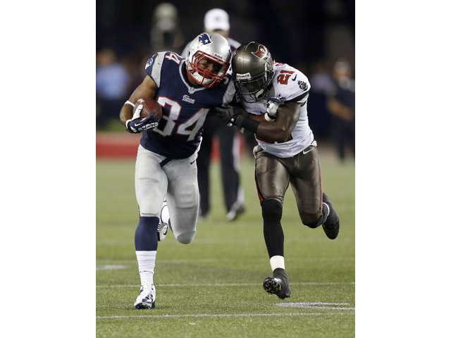 Tampa Bay Buccaneers defensive back Michael Adams (21) chased down New England Patriots running back and Valencia graduate Shane Vereen (34) on Friday in Foxborough, Mass.