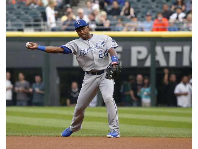 Kansas City Royals second baseman Miguel Tejada fields his position during the first inning of a baseball game against the Chicago White Sox.