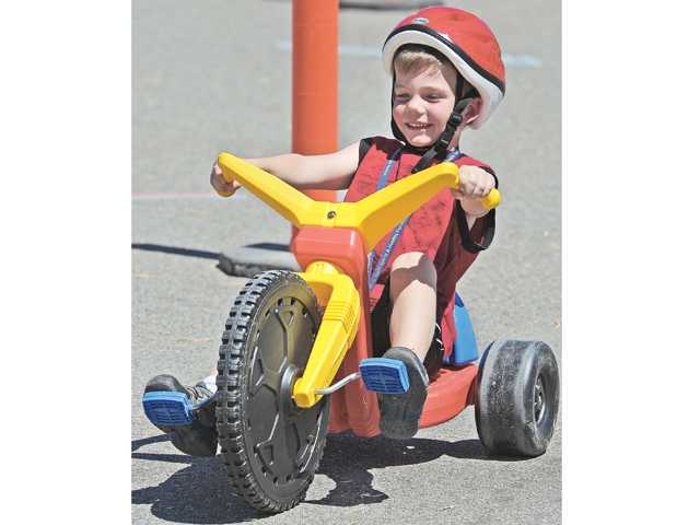 Brody Bayliss, 5, of Canyon Country peddles his trike on the tricycle obstacle course at the fifth annual Youth Sports and Healthy Family Festival held at the Santa Clarita Sports Complex in Santa Clarita on Saturday.