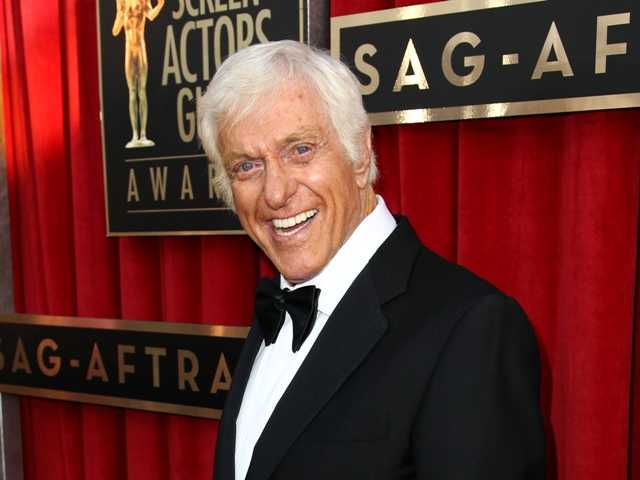 A CHP officer said witnesses reported an elderly man was slumped over behind the wheel of the flaming car. Dick Van Dyke's Jaguar caught fire on a L.A. freeway.