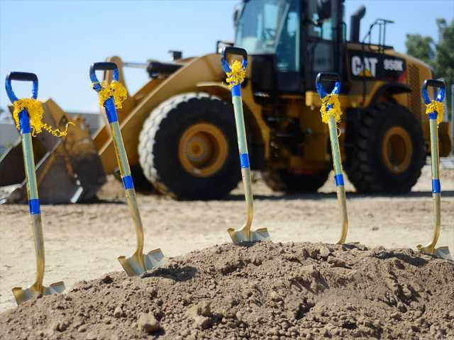 The shovels used for the groundbreaking of the new Culinary building at College of the Canyons sit in the dirt at the construction site on Monday. Photo by Steve Palma for The Signal.