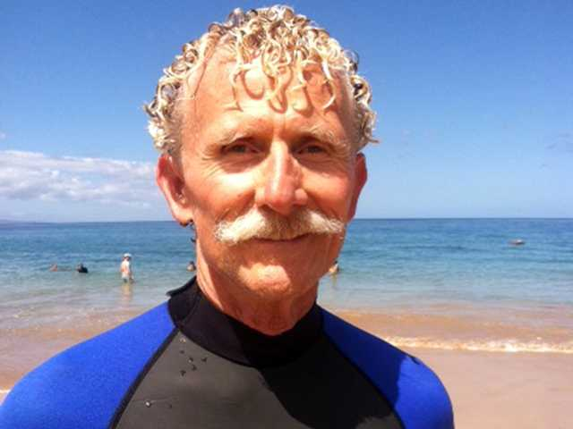 California high school teacher Rick Moore jumped into the water at Maui, Hawaii to rescue a shark attack victim who lost her arm. The woman died n Wednesday.