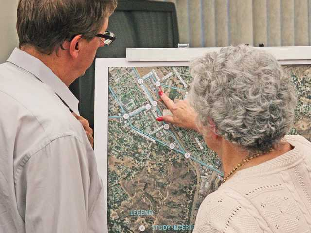 Attendees view a map of a proposed project to expand Dockweiler Drive during a meeting at Santa Clarita City Hall Wednesday night. Photo by Luke Money.
