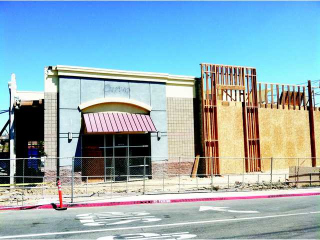 A recently constructed building is being partially torn down and reconfigured by the company that built it — Intertex Companies — to make room for a drive-through Starbucks.