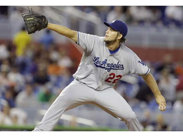 Los Angeles Dodgers starting pitcher Clayton Kershaw throws in the first inning against the Miami Marlins, Thursday in Miami.