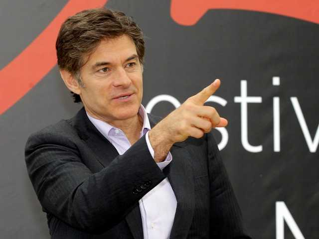 Dr. Mehmet Oz rushed to an accident scene after a yellow cab jumped the curb and struck a pedestrian outside New York's Rockefeller Center.