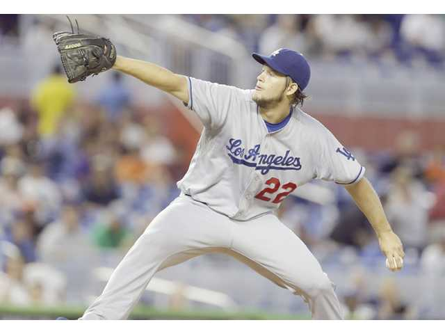 Los Angeles Dodgers starting pitcher Clayton Kershaw throws in the first inning against the Miami Marlins on Thursday in Miami.