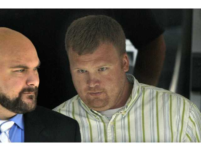 Matt Sandusky, adopted son of Jerry Sandusky, right, leaves the Centre County Courthouse in Bellefonte, Pa. on June 20, 2012.