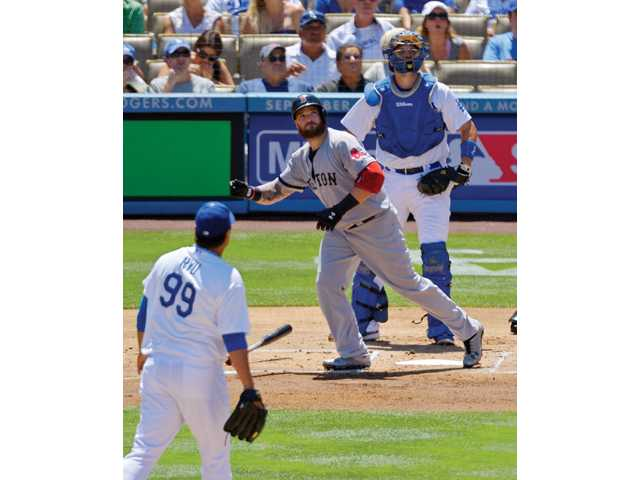 Boston Red Sox's Jonny Gomes, center, hits a three-run home run as Los Angeles Dodgers starting pitcher Ryu Hyun-Jin.