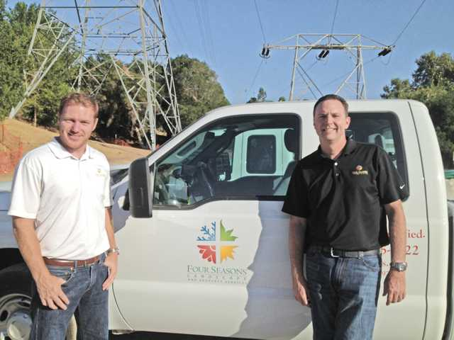 Brian Daly, left, and Dan Blumel formed Four Seasons Landscape and Property Services in 2012, with gross sales now reaching $10 million a year.