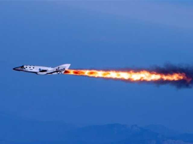 "In this April 29, 2013 photo provided by Virgin Galactic, the company's SpaceShipTwo fires its rockets over Mojave, Calif. after it was dropped from its ""mothership,"" WhiteKnightTwo. It is one of several new private ventures that involve taking people into outer space for a price."