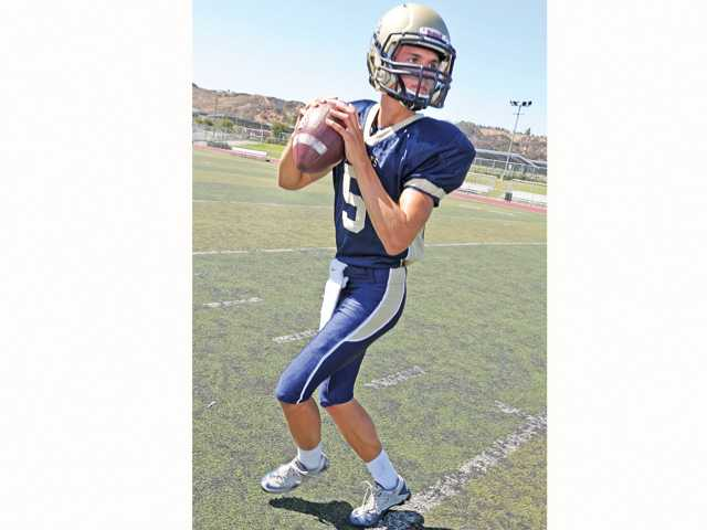 West Ranch quarterback is handiling the hype associated with a new coach and a new offense well. The junior won the job in the spring and has the support of teammates.