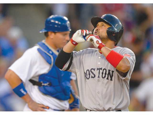 Boston Red Sox's Shane Victorino, right, points to the sky as Los Angeles Dodgers catcher A.J. Ellis looks on Sunday in Los Angeles.