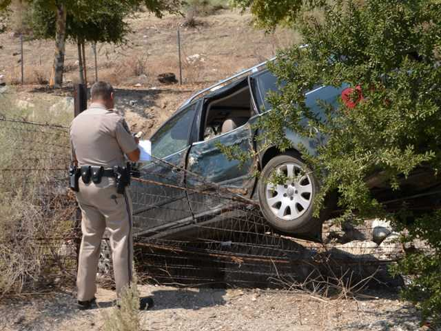 One person was injured when a minivan ran off the northbound Highway 14 freeway, coming to rest on top of a fence near Lost Canyon Road. Rick McClure/For The Signal