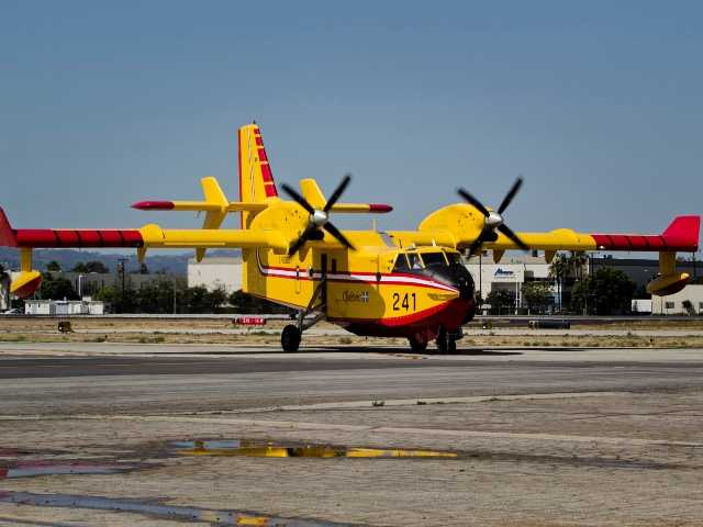 One of two so-called Super Scooper water-dropping aircraft was on display at Van Nuys Airport on Monday. They have a maximum water capacity of 1,600 gallons. Charlie Kaijo/For The Signal