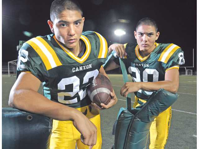Twin brothers Israel Cabrera, left, and Liam Cabrera are both headed into their junior year at Canyon. The two of them are playing wide receiver on offense and side-by-side at safety on the defensive side.