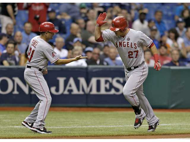 Los Angeles Angel Mike Trout, right, celebrates with third base coach Dino Ebel after his fourth-inning home run off Tampa Bay Rays starting pitcher Roberto Hernandez on Tuesday in St. Petersburg, Fla.