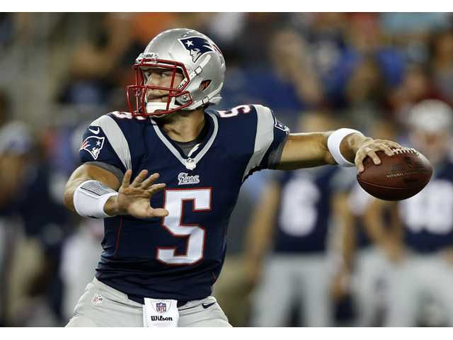 New England Patriots quarterback Tim Tebow passes against the Tampa Bay Buccaneers in the third quarter Friday in Foxborough, Mass.